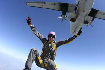 Jumping out of an airplane, ready to skydive