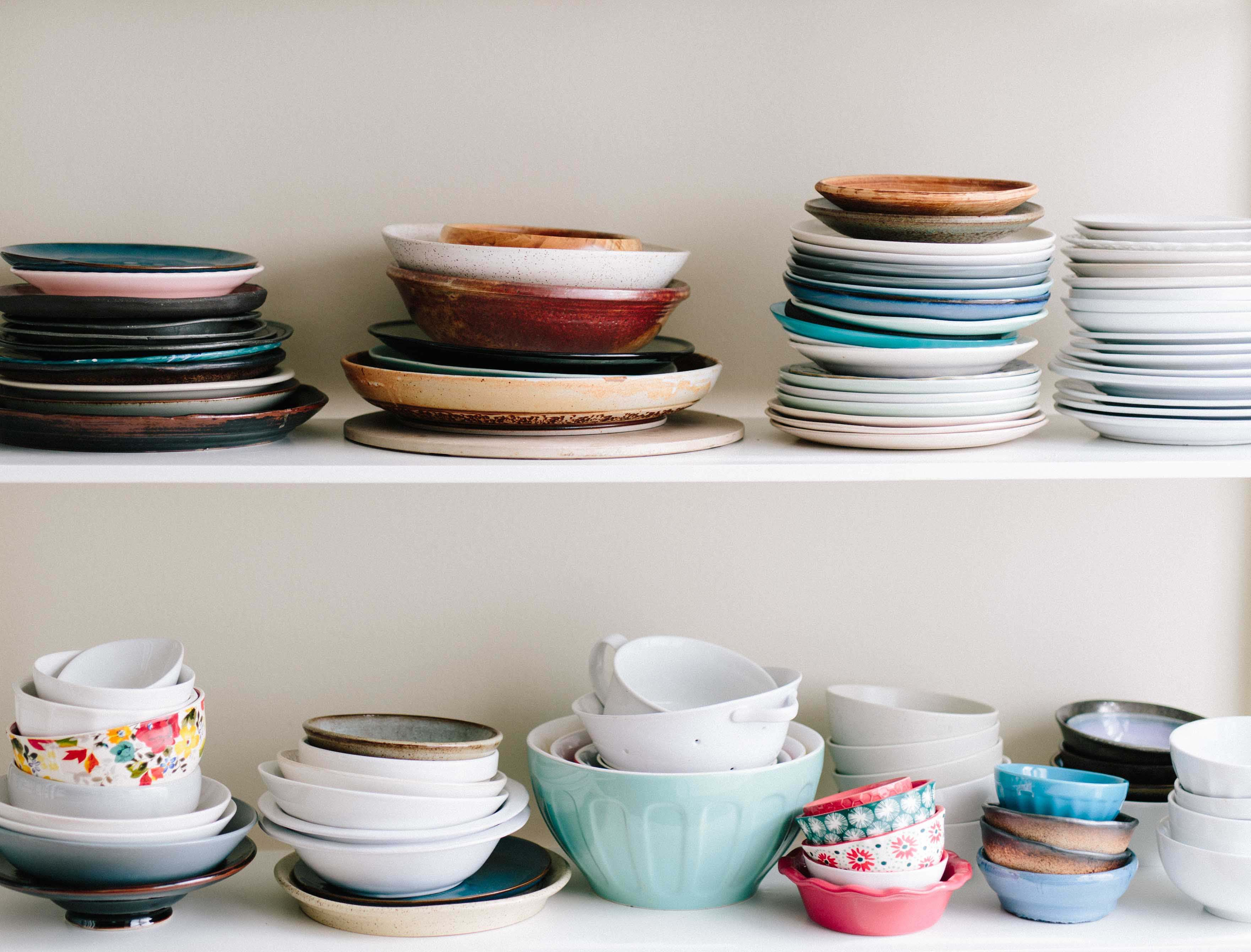 Stacks of dishes in a shared kitchen