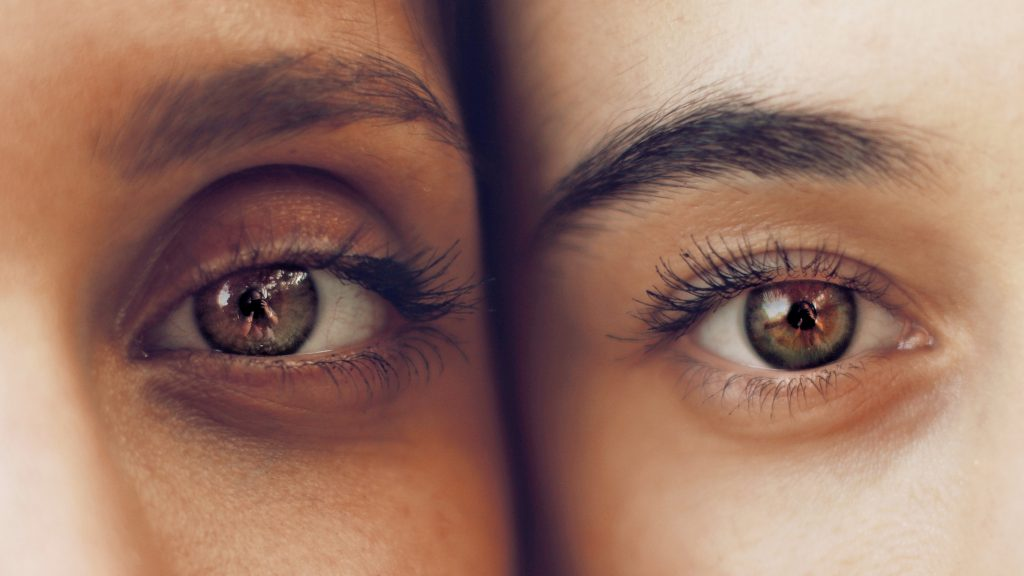 Two People with Eyes Wide Open